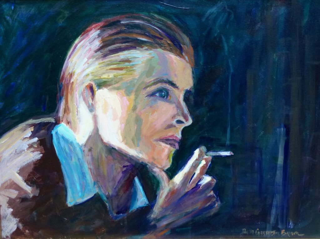 David Bowie smoking a cigarette looking reflective